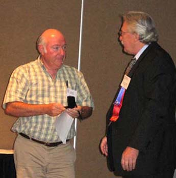 Geoff Bell receiving a Presidential Award for his work as Librarian from Charles Moore, President of the C.N.A.