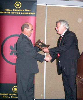 Chuck Moore presenting a Presidential Award to David Dingwall on behalf of the Royal Canadian Mint