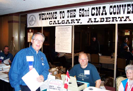 Neil Probert, President Calgary Numismatic Society, Mark Mogen, Emily Richardson