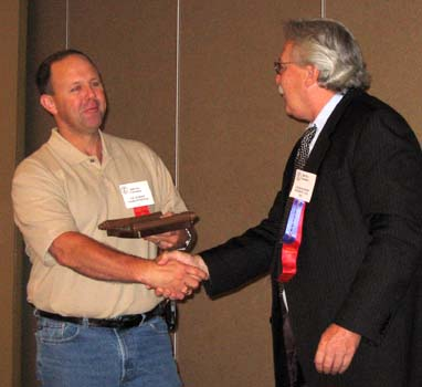 Vic Schoff receiving a Special Appreciation Award from Charles Moore, President of the C.N.A.