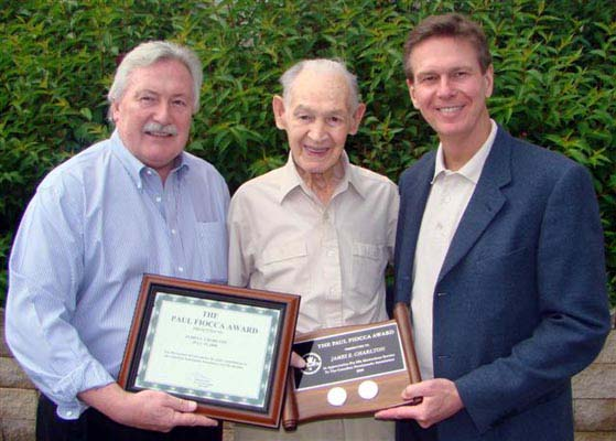 Charles Moore and Paul Winkler, Trajan Publishing Corporation, presenting James E. Charlton with the Paul Fiooca Award
