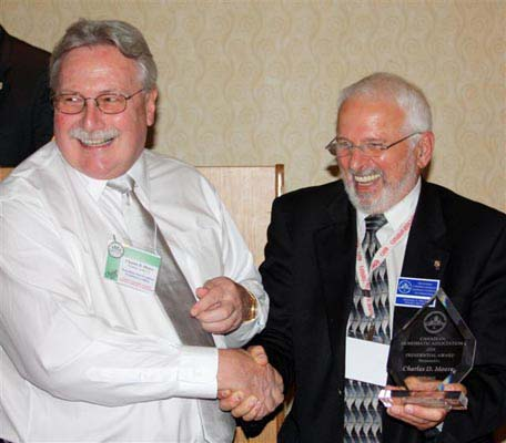 Charles Moore receiving a Presidential Award from Michael Walsh