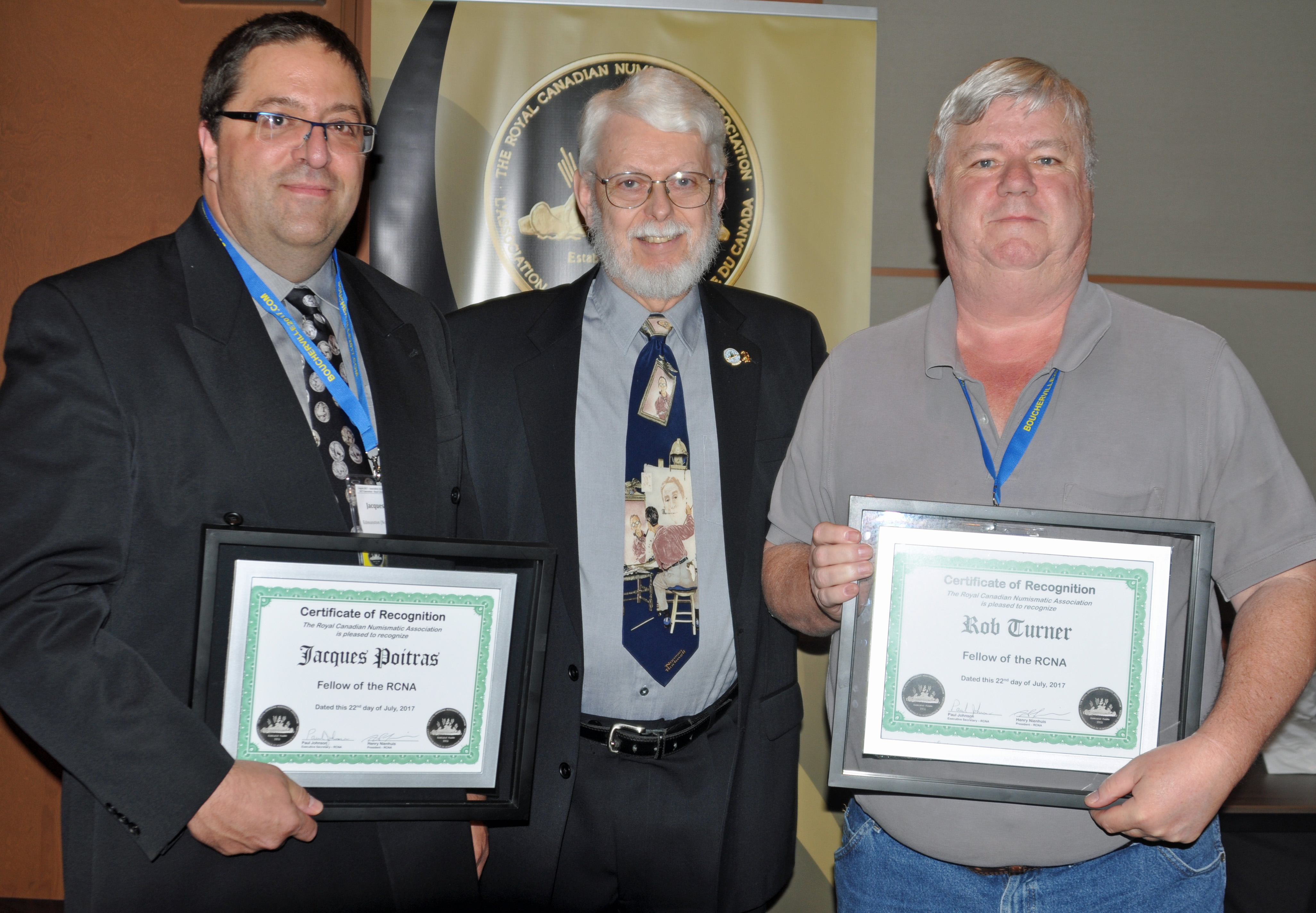 <p><strong>Jacques Poitras</strong> (left) and <strong>Rob Turner</strong> (right) receiving the Fellow Award from <strong>Paul Petch</strong> (center).</p>
