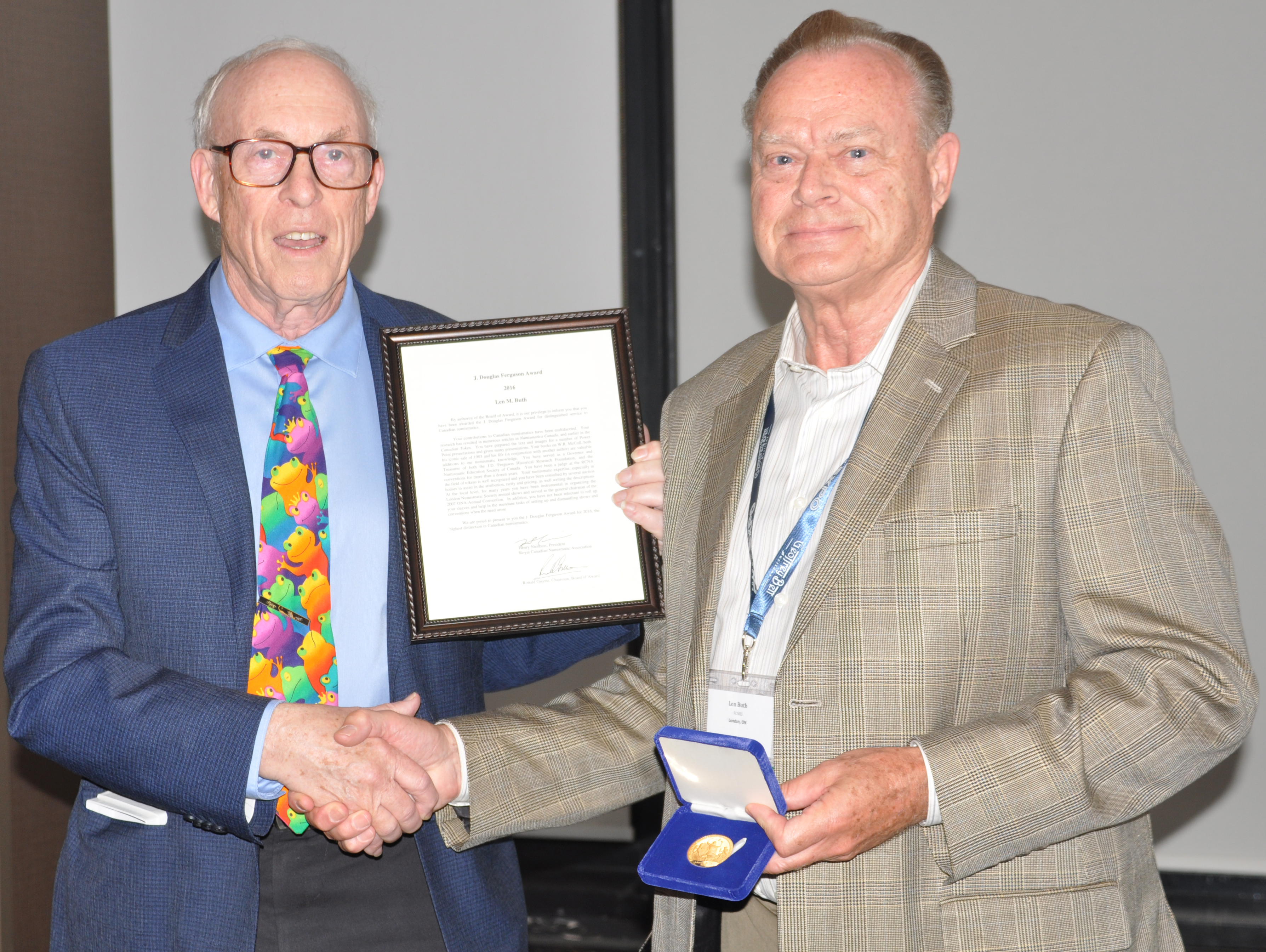 <p><strong>Len Buth</strong> (right) receiving the J. Douglas Ferguson Award from <strong>Ron Greene</strong> (left).</p>